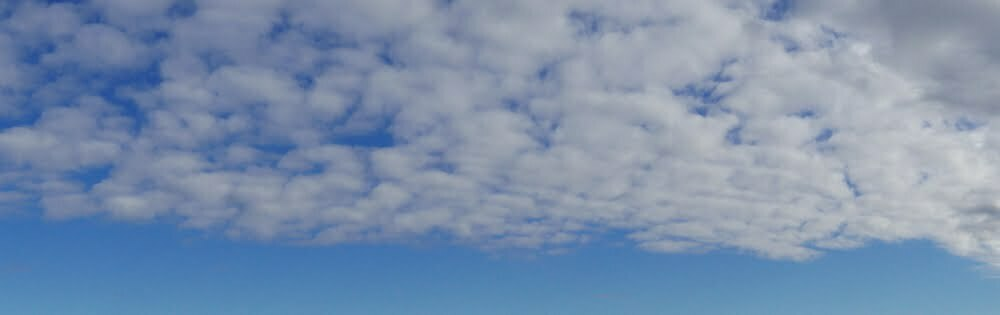 Blue sky with whisps of white cloud